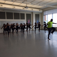 Kwami Shaka Opare leads a West African dance class.