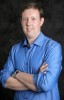TU master's grad Chris Worthington is income editor-in-chief at  Wall Street Daily.