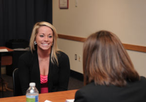 Female student participating in a speed mentoring night