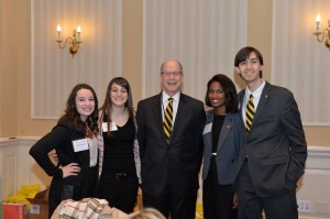 Interim President Timothy J. L. Chandler (center) with students